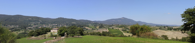 View of Palazzone from Amantino hamlet, with Fighine and Mount Amiata on its background